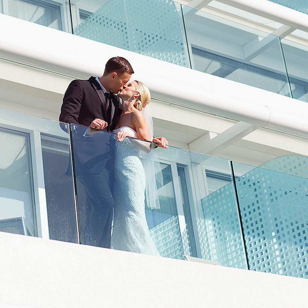 Couple kissing on balcony