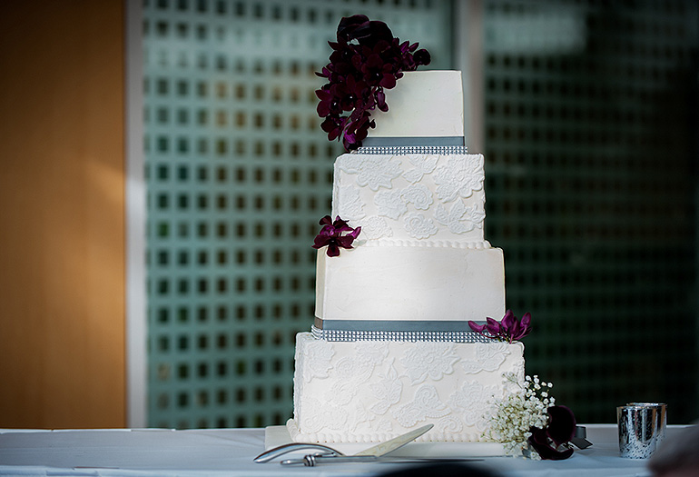 Tall wedding cake with purple accents