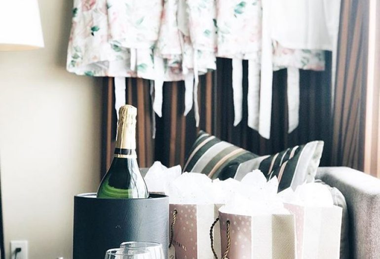 bridesmaid robes hanging with champagne