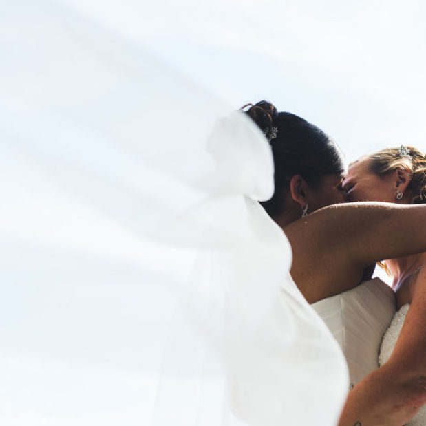 Brides kissing on wedding day