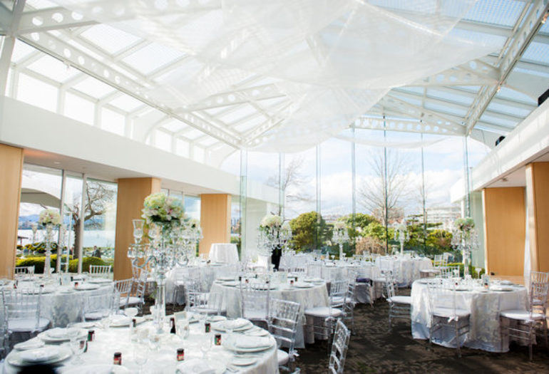 Waterfront wedding reception with white decor