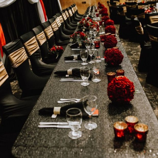 Wedding reception, head table, black, red, gold