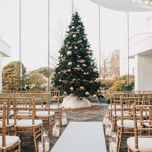 indoor wedding ceremony around large Christmas tree