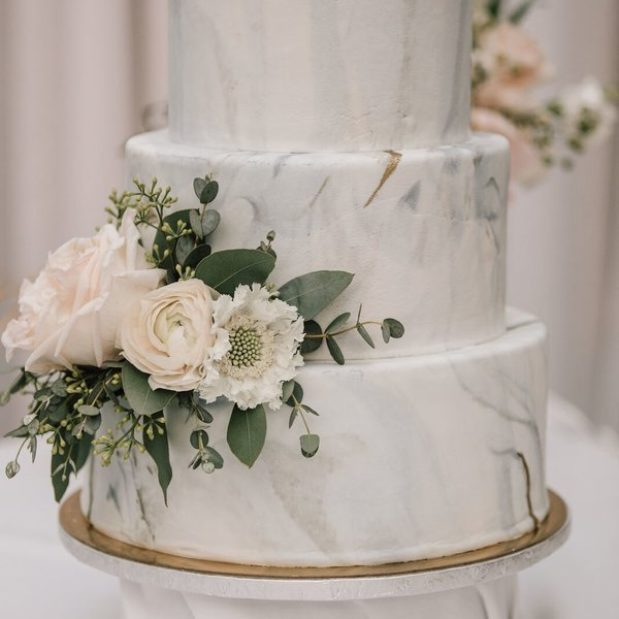 Three tiered marble wedding cake with florals