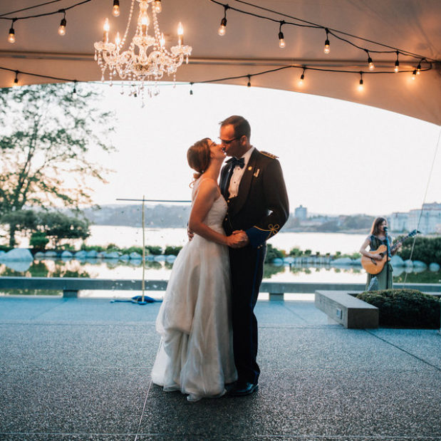 Bride and groom first dance at waterfront outdoor wedding reception