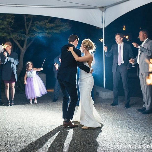 Bride and groom first dance at outdoor wedding venue