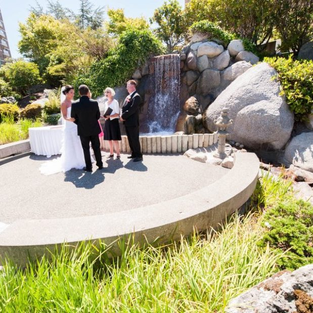 Elopement ceremony by Japanese Garden waterfall