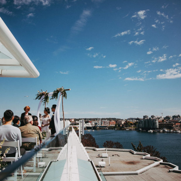 Small outdoor penthouse wedding ceremony, views of Victoria B.C. harbour