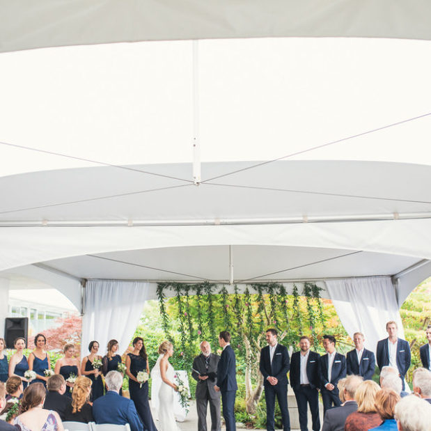 Outdoor wedding ceremony under tents