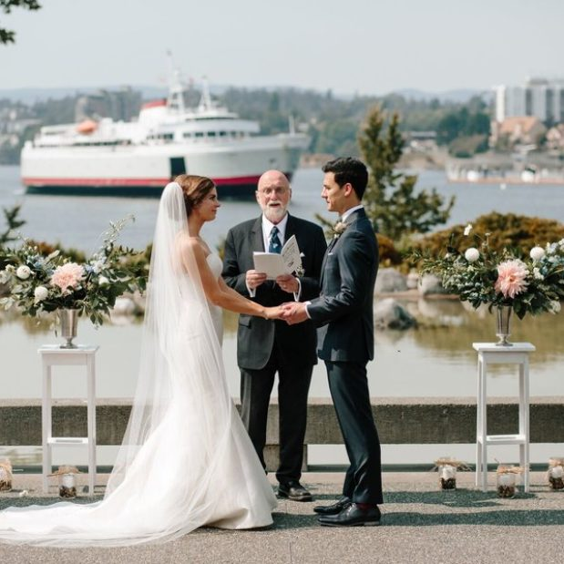 Waterfront wedding vow exchange