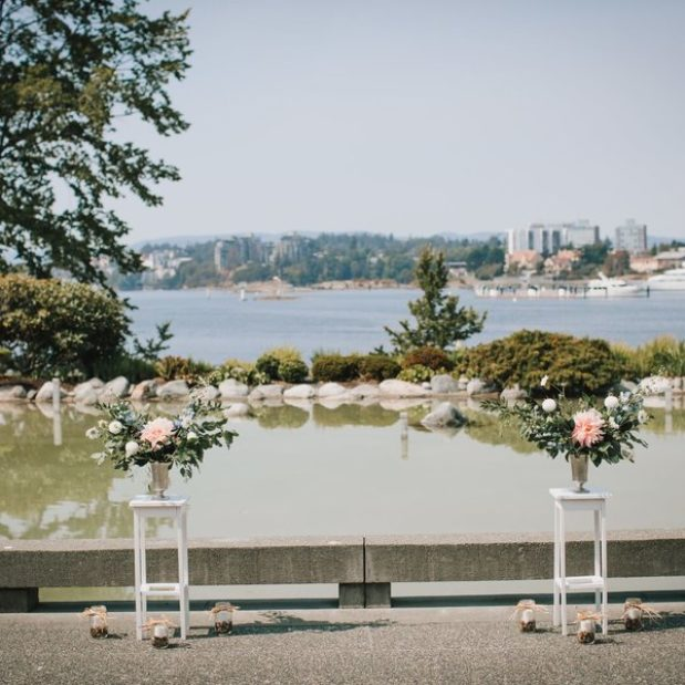 Outdoor wedding ceremony floral decor