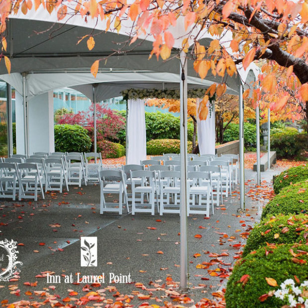 Outdoor fall wedding ceremony set-up under tents