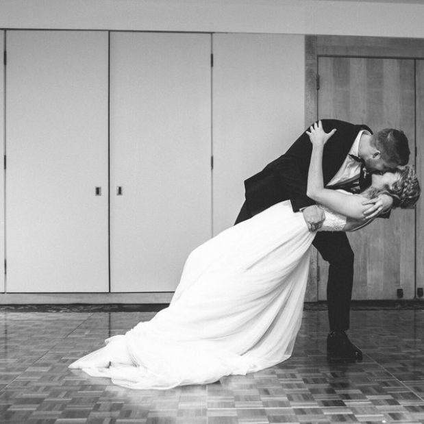 Bride and groom kissing, first dance