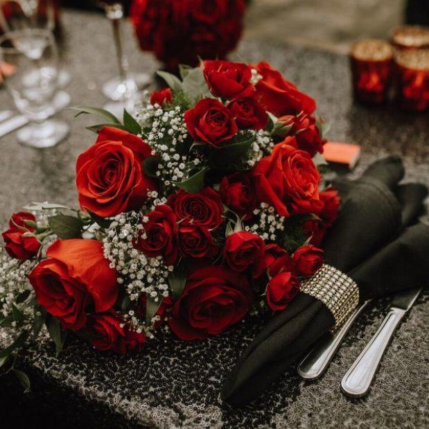 Wedding decor with black linen and red roses