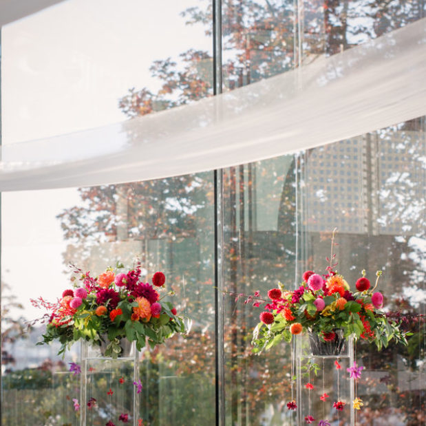 Wedding reception with colourful floral pillars