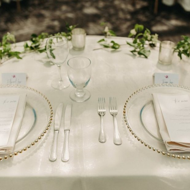 Wedding reception place setting with gold charger plates