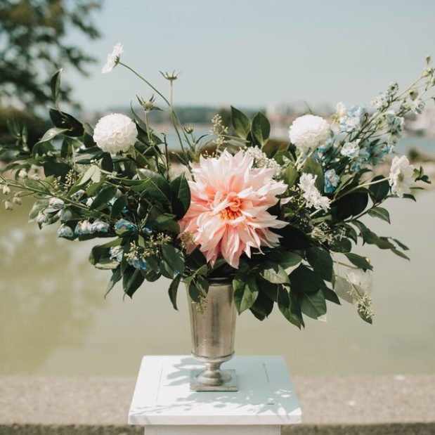 Floral display for waterfront wedding ceremony