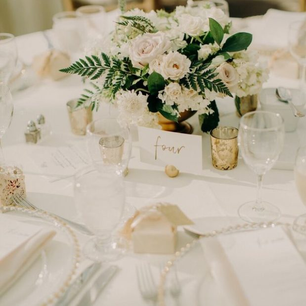 White rose and greenery centrepieces