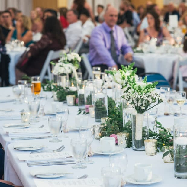 Wedding reception with white and green decor