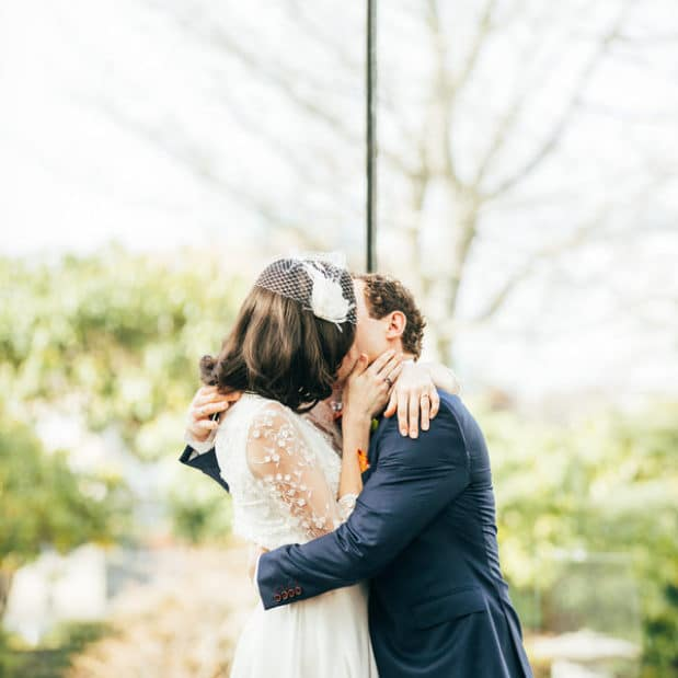Bride and groom sharing a kiss during spring wedding