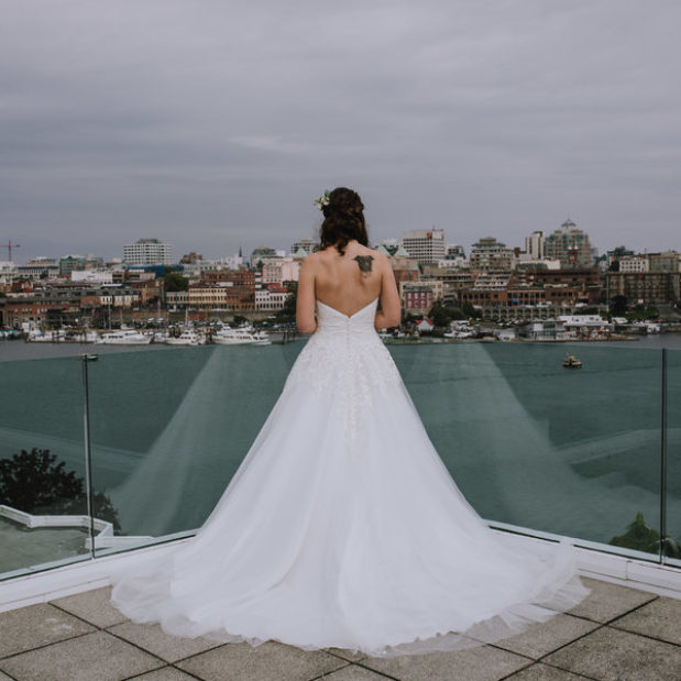 Bride on waterfront patio before wedding ceremony