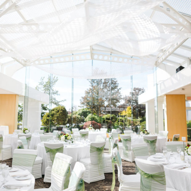 Wedding venue with white and green decor