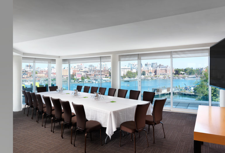 Inn at Laurel Point penthouse meeting room Rogers Suite set for boardroom meeting, views of Victoria's Inner Harbour