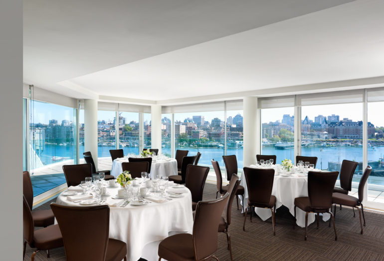 Inn at Laurel Point penthouse meeting room Rogers Suite set for dinner, views of Victoria's Inner Harbour