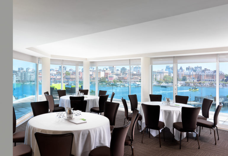 Inn at Laurel Point penthouse meeting room Rogers Suite set for meeting, views of Victoria's Inner Harbour