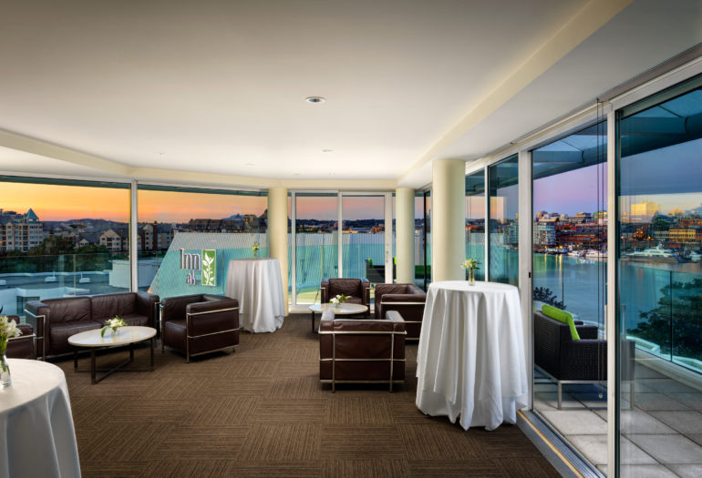 Inn at Laurel Point penthouse meeting room Rogers Suite set for reception, evening views of Victoria's Harbour