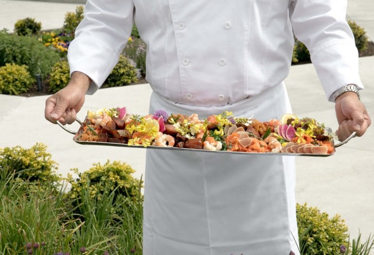 sea food platter help by a chef in garden Inn at Laurel Point