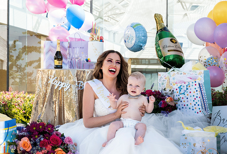 Bride, baby, presents, balloons, set for a party - Inn at Laurel Point