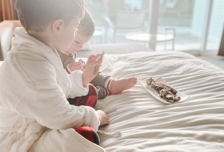 kids having a snack in bed Inn at Laurel Point